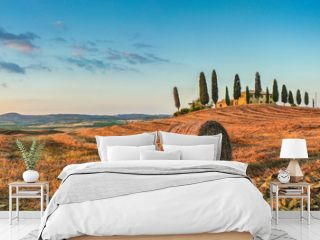 Tuscany landscape with farm house at sunset, Val d'Orcia, Italy