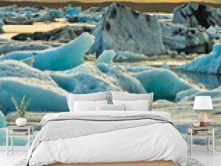 Melting of icebergs at Jokulsarlon glacier lagoon at sunset