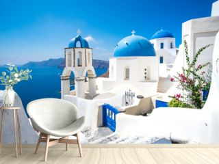 Scenic view of white houses and blue domes on Santorini