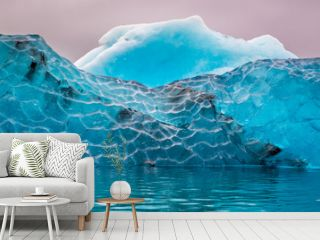 Blue iceberg in cold lake, Iceland