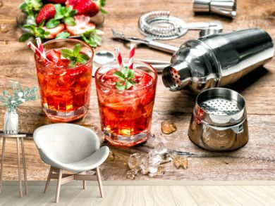 Red drink with ice. Cocktail making bar tools