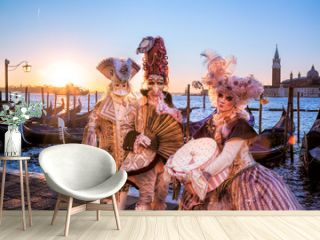Carnival masks against sunrise in Venice, Italy