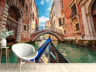 View from gondola during the ride through the canals of Venice i