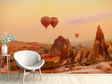 Hot air balloons flying over the picturesque Cappadocia region, Turkey