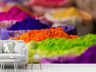 Colorful piles of powdered dyes used for Holi festival in India