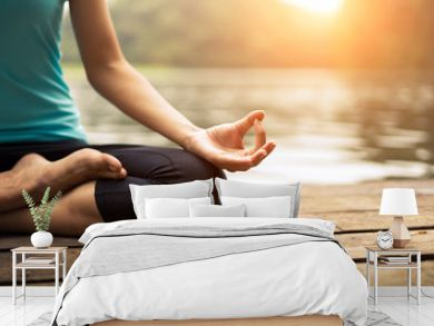 Close up hand. Woman do yoda outdoor. Woman exercising yoga at the nature background, select focus
