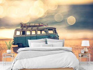 Vintage miniature van in vintage color tone, travel concept