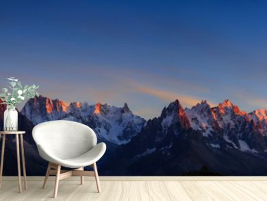 Panorama of the Alps near Chamonix, with Aiguille Verte, Les Drus, Auguille du Midi and Mont Blanc, during sunset.