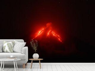 Night view of eruption Klyuchevskoy Volcano, current lava flows on slope of volcano. Eurasia, Russian Far East, Kamchatka Peninsula, Klyuchevskaya Group of Volcanoes.