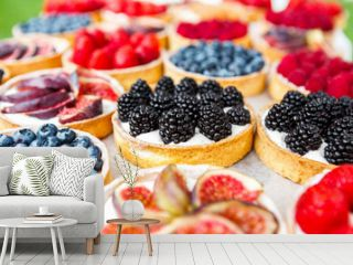 Closeup of blackberry tart dessert tray assorted