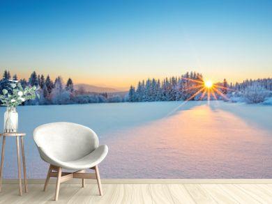 Majestic sunrise in the winter mountains landscape.