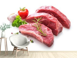 Pieces of raw roast beef meat with ingredients