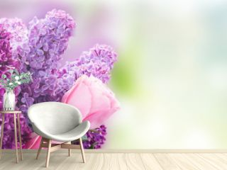 fresh purple Lilac flowers with pink roses close up over gqrden bokeh background banner