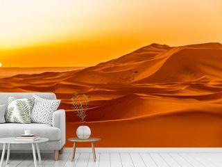 Sunrise over the sand dunes of Erg Chebbi in Sahara , Morocco