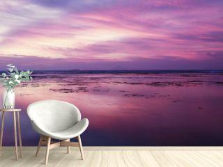 Beautiful sunset with purple sky on beach