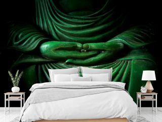 Asian ways of Peace and Meditation in Tao and Zen. Closeup emerald stone buddha hand.
