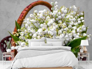 Bouquet of white little flowers in the basket