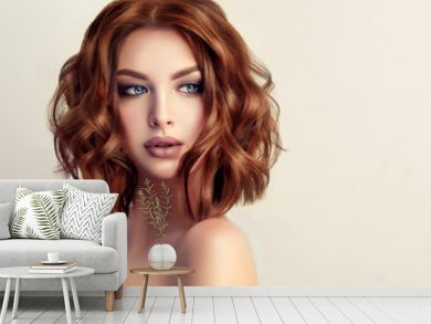 Beautiful model girl with short hair .Woman with red curly hair. Red head .