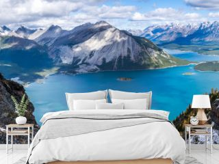panorama of canadian rockies with blue green lake and mountains