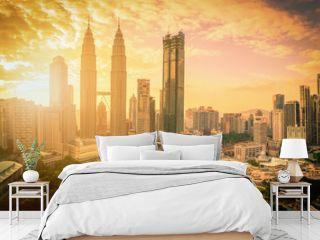 Cityscape of Kuala lumpur city skyline at sunset with sunlight in Malaysia.