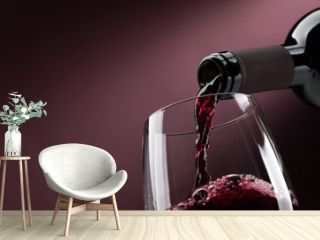 Pouring red wine into a wineglass