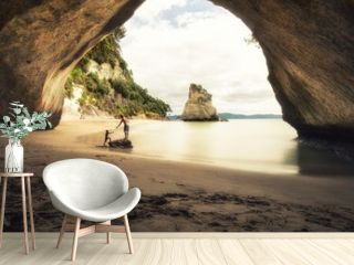 People at Cathedral Cove beach in New Zealand