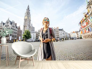 Young woman tourist walking on the Great Market square during the morning in Antwerpen, Belgium