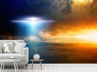 Extraterrestrial aliens spaceship in red glowing sky