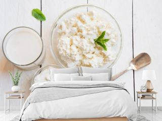 Dairy products in glass dishes on White wood