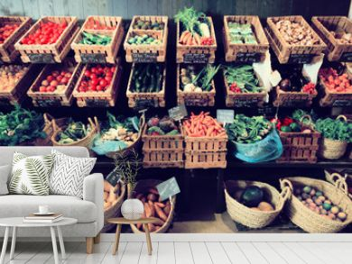 vegetables and fruits in wicker baskets in greengrocery