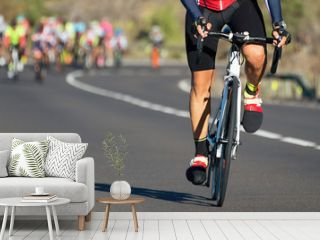 Cycling competition,cyclist athletes riding a race,climbing up a hill on a bicycle,cyclist in an escape