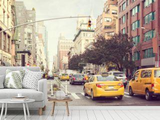 Citylife and traffic on Manhattan's avenue, New York City,  United States.  Toned image