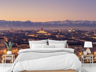 Turin, Italy: cityscape at sunrise with details of the Mole Antonelliana of Torino