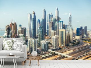 Scenic panoramic view of modern city architecture. Aerial daytime skyline of Dubai Marina, UAE, with skyscrapers and highways. Summer travel background.