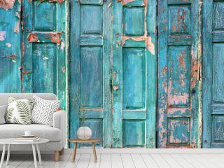 Texture of the old door. Peeling paint on wooden doors as a deta