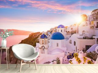 Sunset view of the blue dome churches of Santorini, Greece.