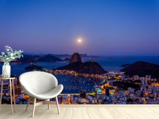 View to Pao de Acucar (Sugar Loaf Mountain) during beautiful  full moon at Mirante Dona Marta (Dona Marta viewpoint) , Rio de Janeiro, Brazil