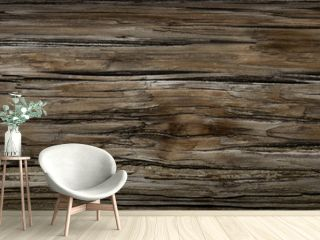 Old Dark rough wood floor or surface with splinters and knots. Square background with flooring or boards with wood grain. Old aged timber in a barn or old house.