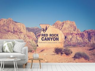 Rock boulder sign for Red Rock Canyon in Las Vegas Nevada with mountains in the background