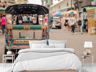 Tuk Tuk (Thai traditional taxi car) parking for wait a tourist passenger at famous backpacker street in Bangkok (Khao San road), landmark and popular for tourist , sightseeing in Bangkok, Thailand