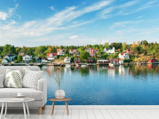 Small islands in the morning near to Stockholm. Swedish landscape with traditional red houses