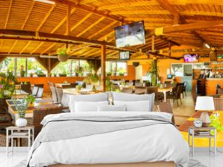 Indoor panorama of rustic restaurant and bar in a Black Sea resort.