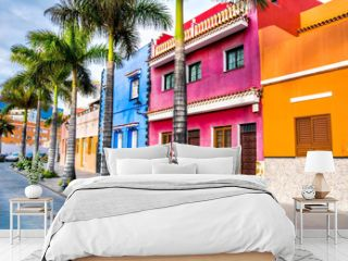 Tenerife. Colourful houses and palm trees on street in Puerto de la Cruz town, Tenerife, Canary Islands, Spain