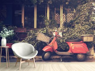 retro scooter in italy, traditional style motorcycle with foliage background (image with vintage effect)