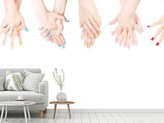Hands with colored nail polish set in the row
