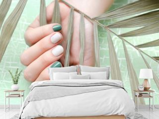 Female hands with green nail design