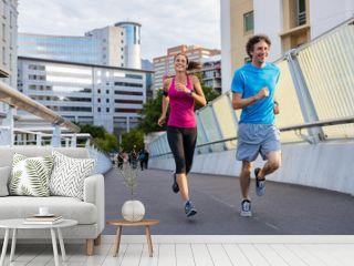 Smiling mature couple jogging