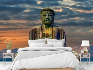 Image of buddha with mountains at dawn background