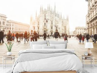 Blurred people walking in front of Duomo square in Milan - Defocused crowd on italian metropolis center