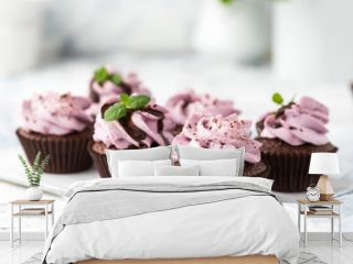 Cocoa cupcakes decorated berry cheese cream and chocolate